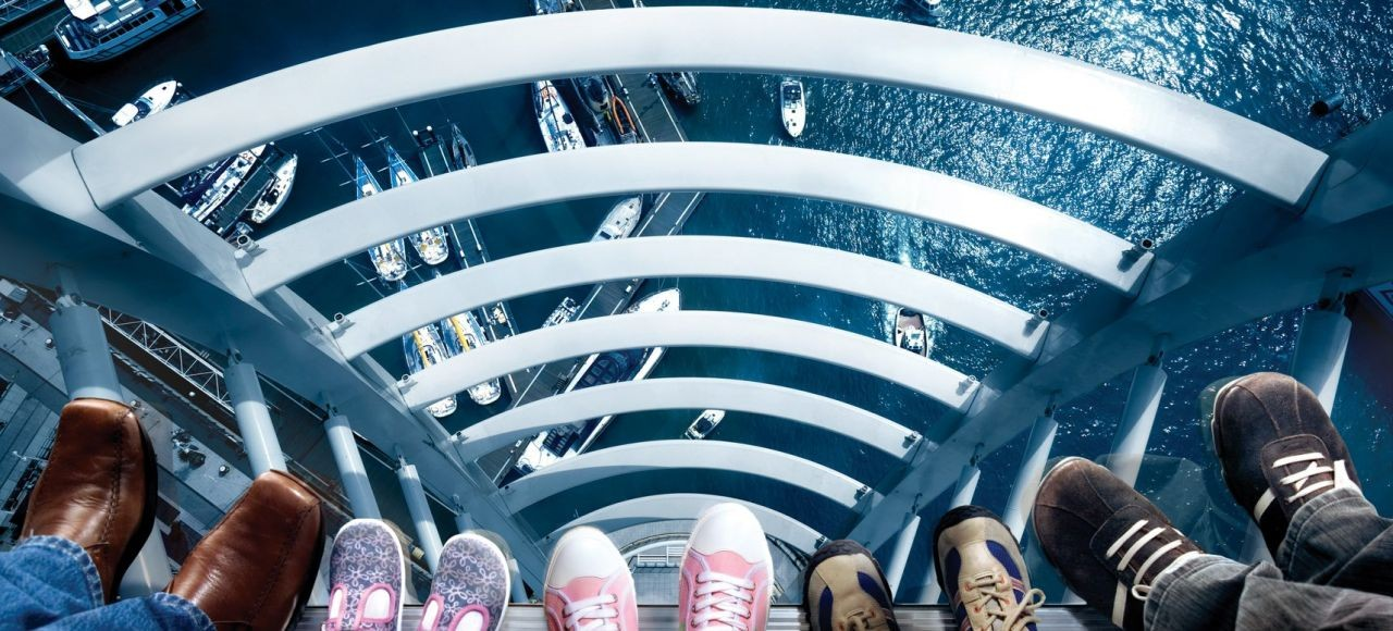 Emirates Spinnaker Tower Sky Walk - people's feet on the glass floor